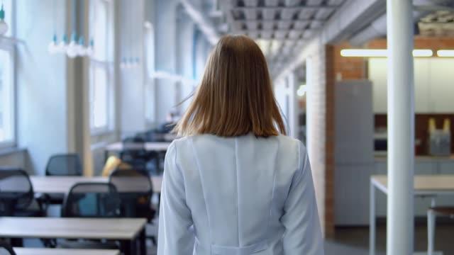 unrecognizable therapist walks indoors