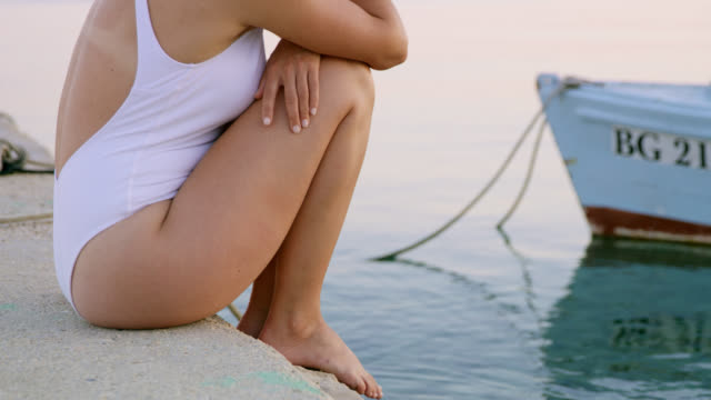 DS Unrecognizable woman relaxing on a pier video