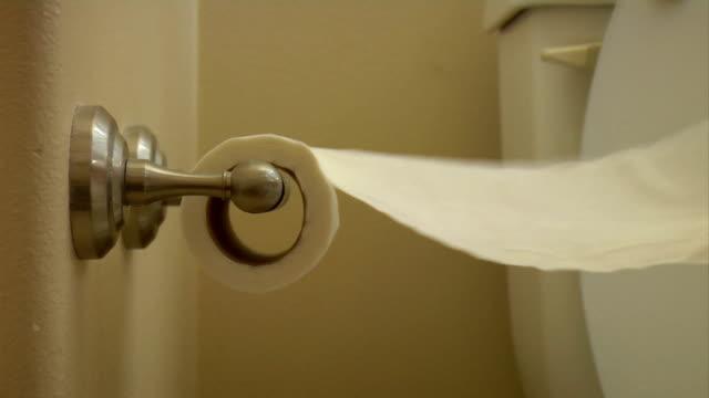 Unroll toilet paper frantic