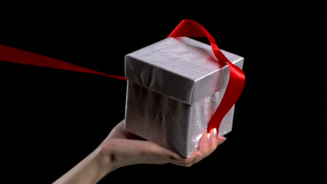 Unwrapping a gift box, Slow Motion video
