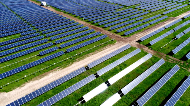 up and away large Solar Panel Power Plant in Texas up and away large Solar Panel Power Plant in Texas with Colorful Solar Panel Power Plant providing Clean Renewable energy to help fight against Climate Change and Create Jobs power stock videos & royalty-free footage