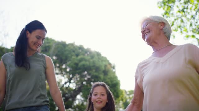 up, up and away! - nonna e nipote camminare video stock e b–roll