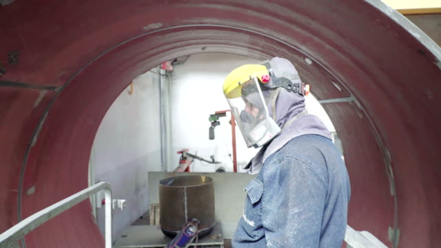uplifting worker with elevator next to autoclave tube - autoclave video stock e b–roll
