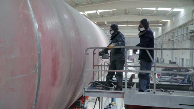 uplifting workers next to big tube - autoclave video stock e b–roll