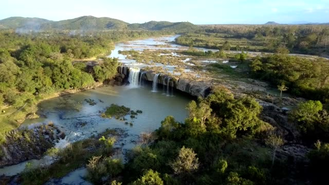 upper approaching abrupt waterfall on wide river - ecosystem stock-videos und b-roll-filmmaterial