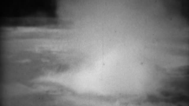 1937: Upper Geyser Basin water violently boils bubbles spits and smokes. video