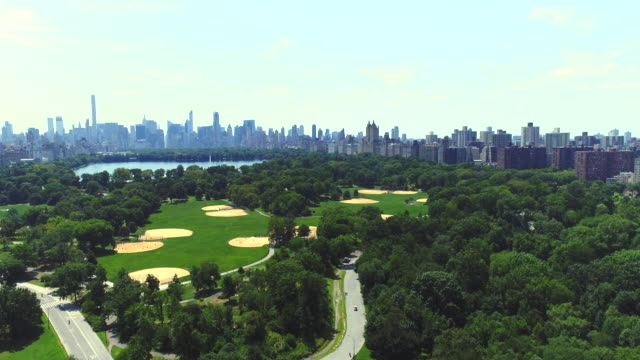 Upper west side Manhattan cityscape with Central park in New York city Aerial Upper west side Manhattan cityscape with Central park in New York city Aerial central park manhattan stock videos & royalty-free footage