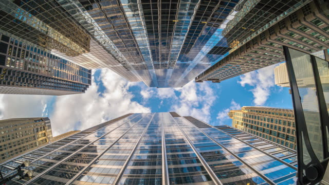 Uprisen angle of Downtown Chicago skyscraper Uprisen angle of Downtown Chicago skyscraper with reflection of clouds among high buildings in fisheye angle, Illinois, United States, Business and Perspective concept, 4K Time lapse chicago architecture stock videos & royalty-free footage