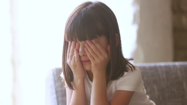 Upset abused child crying feel scared sitting alone at home Upset stressed abused little child crying rubbing eyes feel scared hurt sitting alone at home, sad lonely worried preschool kid girl being punished or bullied, having trauma, unhappy children concept disgust stock videos & royalty-free footage