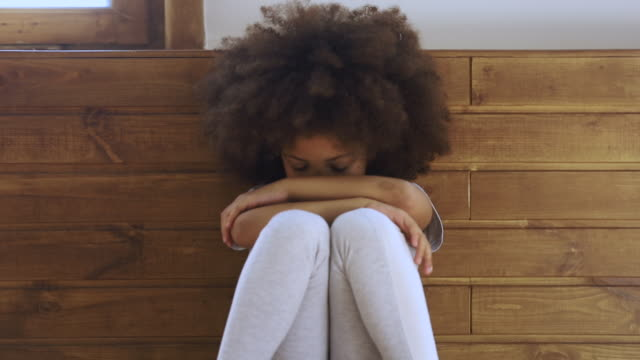 Upset little african american preschool kid girl crying alone Upset little african american preschool kid girl crying alone feeling bullied abused abandoned, sad offended lonely black orphan child stressed or scared sitting on floor, children problems concept mental health stock videos & royalty-free footage