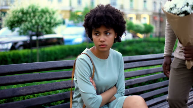 Upset woman leaving boyfriend being late for date, relations conflict, fight