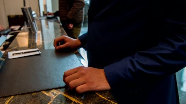 Upstanding entrepreneurship registering at luxury hotel reception video