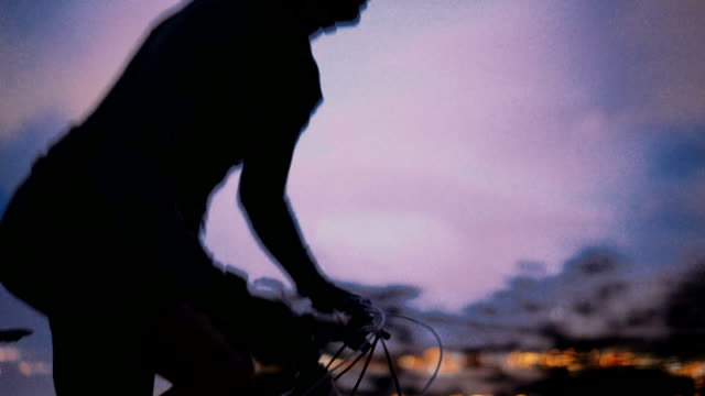 Upward shot of cyclist in pursuit with bicycle on mountain road video