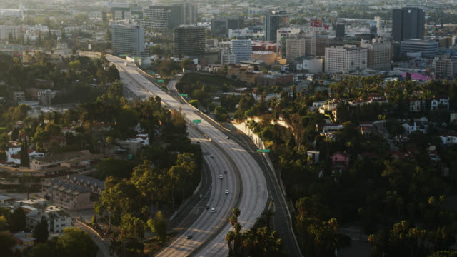 Upward Tilting Drone Shot of Near-Empty 101 in Hollywood with Los Angeles Cityscape During Covid-19 Lockdown