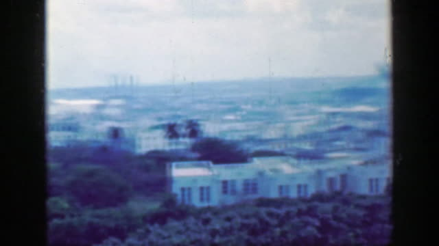 1953: Urban caribbean island landscape buildings factories commercial space. video