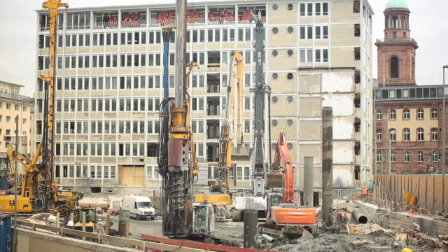 Urban Construction Site Panorama with Machinery Working Urban construction site panorama with machinery at work. construction vehicle stock videos & royalty-free footage