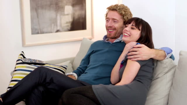 Urban couple watching TV slider video
