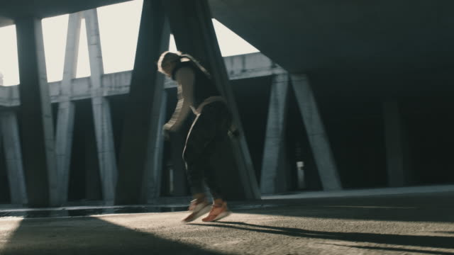 Urban Female Jogger Working Out in a Garage in Urban Area