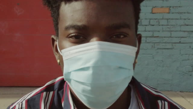 Urban People Black Male Outdoors Wearing Face Mask During Pandemic Virus Outbreak 4K Video Series