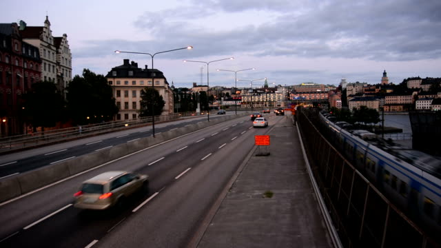 Urban Road and Railroad Tracks in Stockholm City traffic and railroad tracks in Stockholm, Sweden intercity stock videos & royalty-free footage