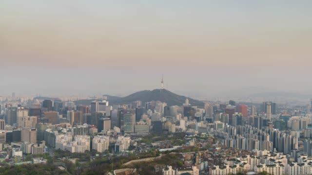 Urban skyline of Seoul, day to night time lapse Urban skyline of Seoul, day to night time lapse namsan seoul stock videos & royalty-free footage