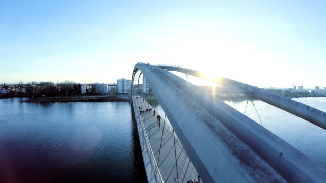 urban sunset panorama. aerial view. fly over bridge. background video