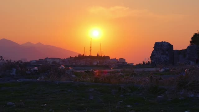 Urban wasteland with ruins and rubbish at sunset Urban wasteland with ruins and rubbish at sunset izmir stock videos & royalty-free footage