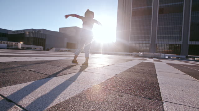 Urban woman practicing roundhouse kick outdoors video