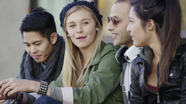 Urban young adults and teenagers hanging out video