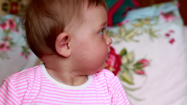 Сurious baby looking up video