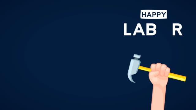 vídeos y material grabado en eventos de stock de celebración del día del trabajo de ei con martillo de elevación de manos - día del trabajo