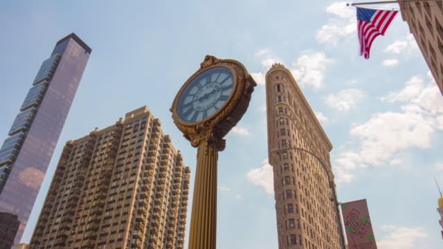 Usa new york manhattan famous flat iron building flag clock 4k time lapse video