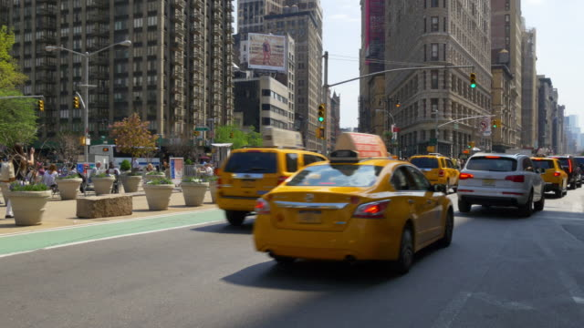 Usa new york summer day flat iron building traffic crossroad 4k video