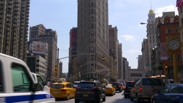 Usa new york summer day traffic street flat iron building down to top 4k video