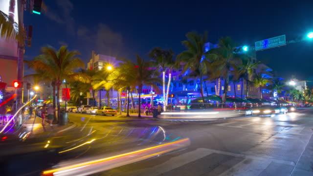 Usa night light miami south beach ocean drive traffic crossroad 4k time lapse video