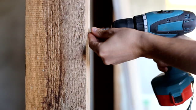 Use a screwdriver in the manufacture of wood products Use a screwdriver in the manufacture of wood products. power tool stock videos & royalty-free footage