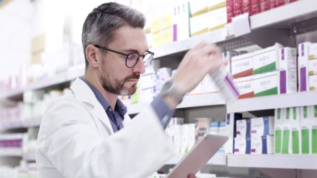 I use social media to promote our products 4k video footage of a pharmacist using a digital tablet while checking stock on the shelves pharmaceutical industry stock videos & royalty-free footage