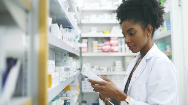 I use the best tools to offer you the best care 4k video footage of a young female pharmacist using her tablet while working in an apothecary pharmacist stock videos & royalty-free footage