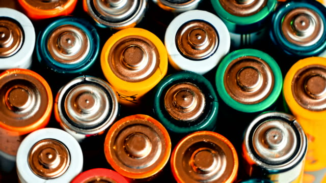 Used batteries from different manufacturers Used batteries from different manufacturers, waste, collection and recycling, high danger for the environment. Batteries background electrical equipment stock videos & royalty-free footage