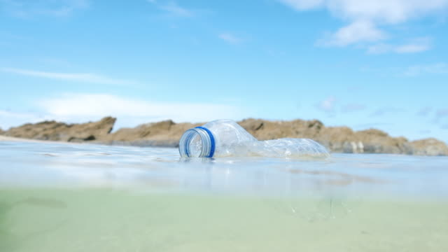 used plastic water bottle floating in the sea. video