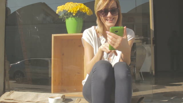 Using cellphone with morning coffee. video