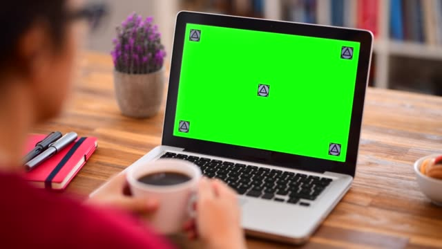 Using chroma key screen laptop computer at office
