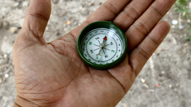 using compass compass in hand guidance stock videos & royalty-free footage