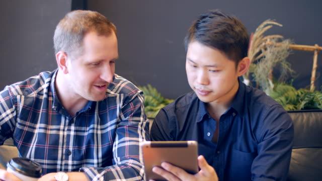 Using digital tablet at cafe video