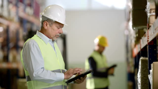 Using Digital Tablet For An Inventory In Warehouse