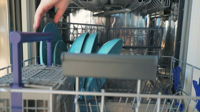 Using dishwasher machine. Woman hands removing clean plates from the dishwaher machine.  The vessels is now ready to be used for cooking or for eating. dishwasher stock videos & royalty-free footage