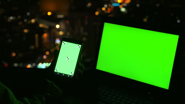 using Laptop and mobile phone green screen on rooftop video