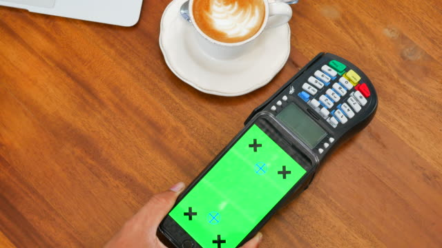 Using mobile for payment with Green screen, Chroma key video