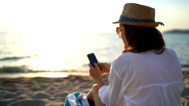 Using phone at the beach