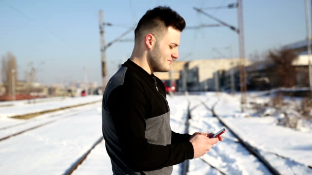 Using phone on railway tracks